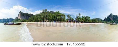 Railay beach in Krabi Thailand. Asia. Panorama of beach with boats, cafes and nature in the background