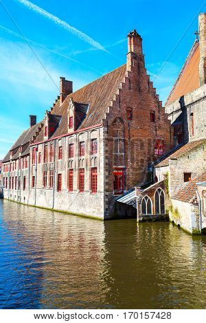 Scenic cityscape with medieval houses and canal view, in Bruges, Belgium