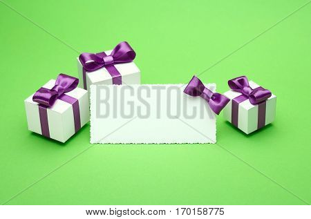 Greeting card with a satin bow, gifts in a beautiful package, for writing greetings card, several boxes of presents, festive mood attributes