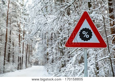 Snowy winter road. Discount star icon. Sale concept. Attention sign. Forest with snow-covered trees. Beautiful wintertime.