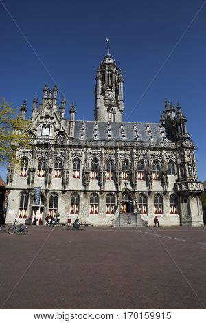 Old medieval townhall of Middelburg The Netherlands with and summer blue sky