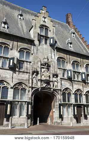 front of Old medieval Dutch gable house and summer blue sky