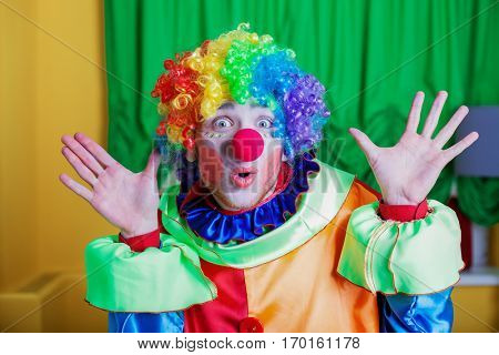 Clown with queer expression on his face.