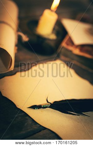 old desk with vintage stationery in candlelight