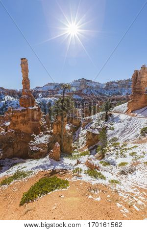 Hoodoos, sun and snow at Bryce Canyon National Park in Southern Utah.