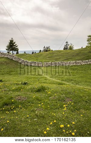 mountain landscape  with a stone wall fence- Dent du Vaulion - Switzerland