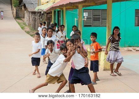 POPOTOTAN ISLAND BUSUANGA PHILIPPINES - JANUARY 202012 - Children playing on a school break in the Philippine village