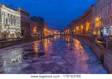 DECEMBER,25,2016, Saint Petersburg, Russia: Moyka river in Saint Petersburg Russia winter night lights, reflection on water.