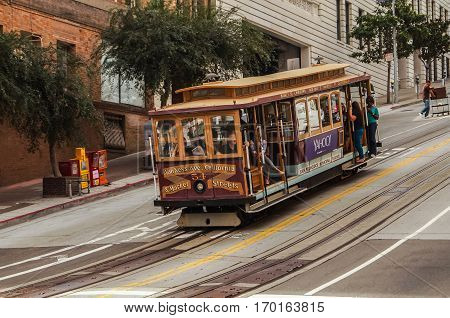 SAN FRANCISCO, Ca, OCTOBER, 08,2015: Passengers ride in a cable car the most popular attraction of San Fransisco.