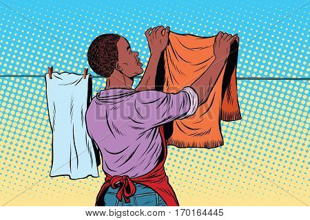 Vintage employee hangs up to dry clothes. pop art retro vector illustration. Homework and cleaning service. African American people
