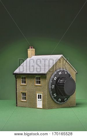 Small model of house with combination lock