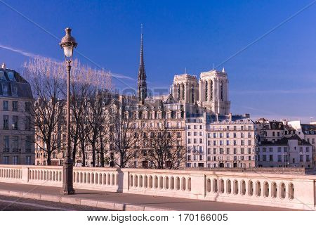 Embankment of the Seine near the Ile de la Cite in the winter morning, Notre Dame in the background, Paris, France