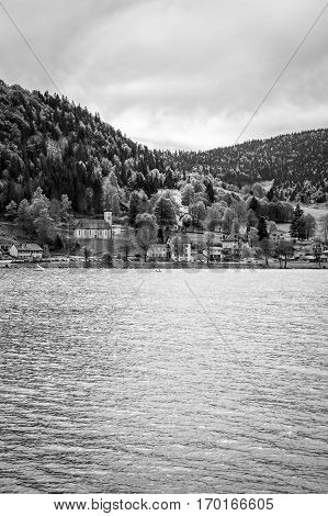 Black and white view on Joux lake -lac de Joux and the Jura mountains Le Pont Switzerland