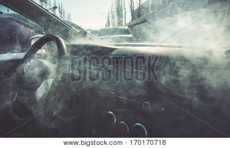Car interior in smoke or vapour. Vape Inside car. Can be used as fire in automobile