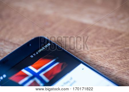 Smartphone With 25 Percent Charge And Norway Flag