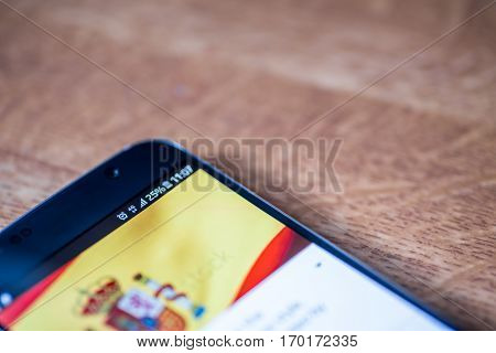 Smartphone With 25 Percent Charge And Spain Flag