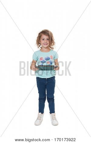 Young girl using tablet device