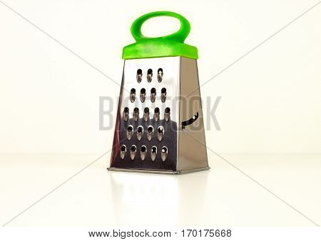 Metallic box grater kitchenware isolated on white background