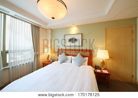 SEOUL - NOV 2, 2015: Bedroom with dounle bed in hotel Fraser Insadong