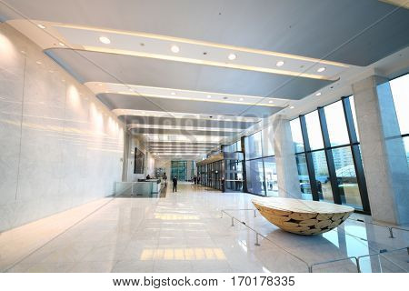 SEOUL - NOV 4, 2015: Spacious hall with doors, wickets and people of Yuksam building. Yuksam Building - pride of Seoul, tallest building in east Asia