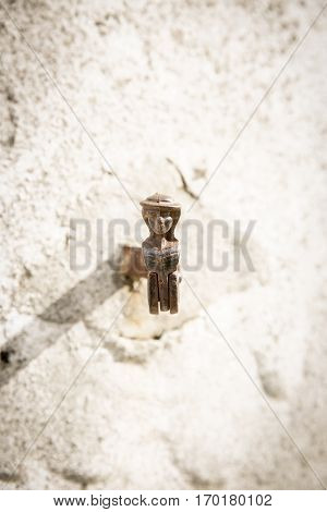 white wall with vintage shutter swing fastener in shape of a man