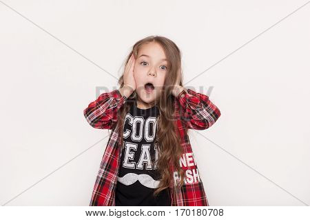 absolutely amazed little girl with problems isolated on white background. Surprised and terrified kid