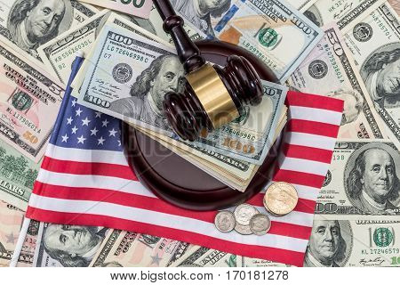hammer of judge of the dollar and the US flag.
