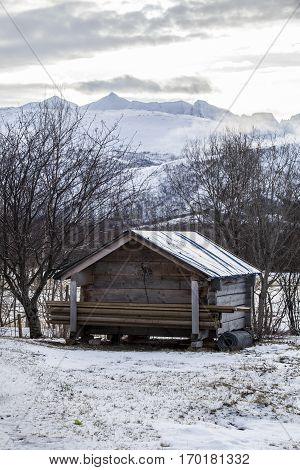Norwegian landscape in the winter with snow and a little wooden shed Nordland Norway;
