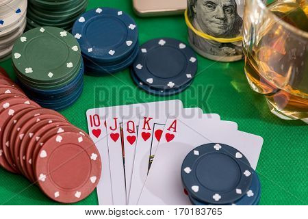 10 To Ace Heart Straight Flush On Poker And Casino Chips, Money On Green Table