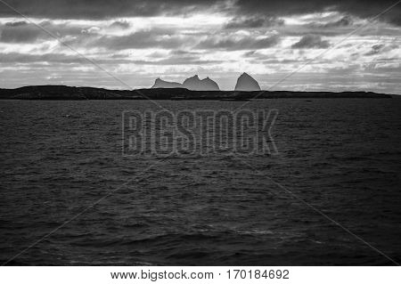 Black and white Norwegian landscape black and white view of the Traena and Sana islands under midnight sun Norway