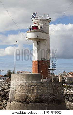 Small white and red lighthouse - Port of Royan on the Atlantic Coast France.