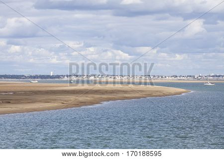 maritime seaside landscape with water sand bank and white cloud garonne estuary near Royan France