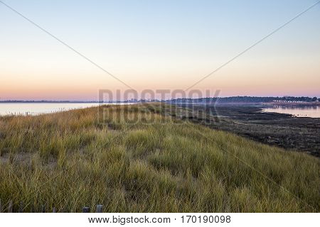 view of sunset over beach of l'Aiguillon sur Mer and the lagoon of nature reserve Casse de la Belle Henriette Vendee France