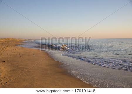 view on a beach at sunset with golden sand and quiet sea, Casse de la Belle Henriette, located between l'Aiguillon sur Mer and la Tranche sur Mer, Vendee, France