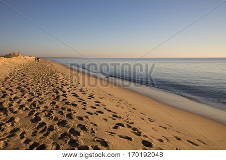 view on a beach at sunset with golden sand an quiet sea, Casse de la Belle Henriette, located between l'Aiguillon sur Mer and la Tranche sur Mer, Vendee, France