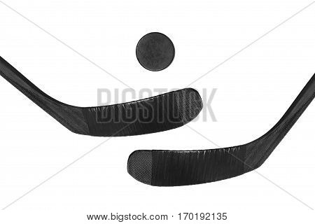 Hockey puck and two sticks on a white background. Isolated