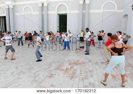 People Making Gym On The Street Of Santiago De Cuba