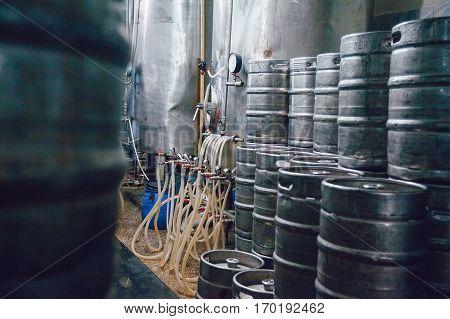 Metal beer kegs stand in beer plant. Brewery.