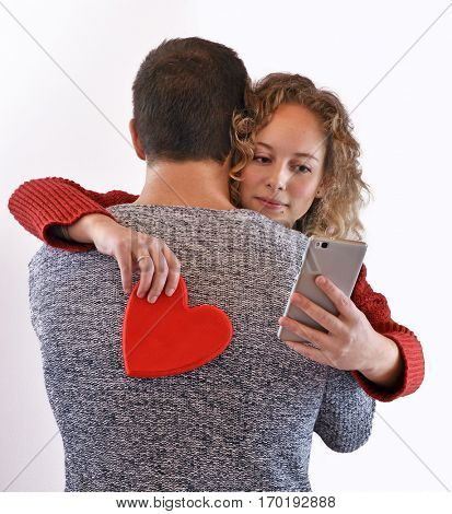 Fake love huge couple and cell phone at lovers day.
