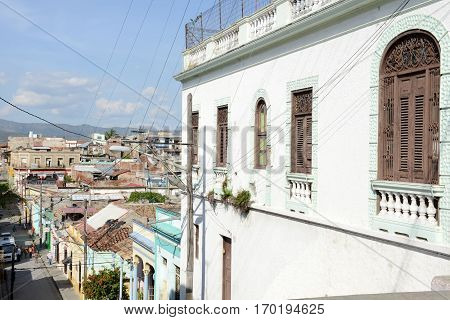 Santiago de Cuba Cuba - 13 january 2016: people walking in front of colonial houses at Santiago de Cuba Cuba