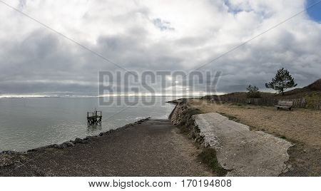 Panoramic view of the coastline and dike proctecting the village of l'Aiguillon sur Mer Vendee France