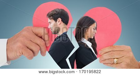 Unhappy couple not speaking to each other against grey vignette