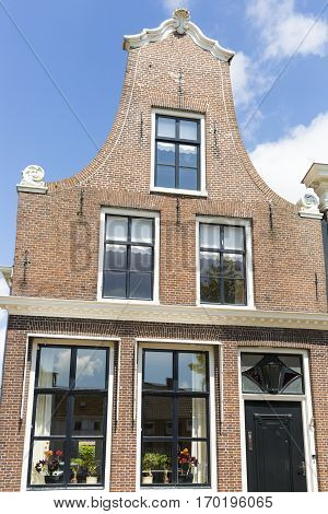Typical Dutch red brick gabble house facade The Netherlands