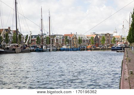 Noorderhaven canal with boats and houses in historic old town of Harlingen Friesland Netherlands