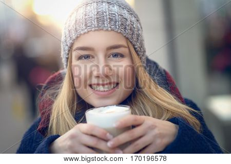 Girl Warming Up With Coffee