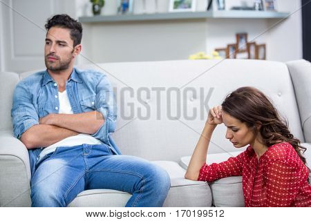 Annoyed couple after argument at home