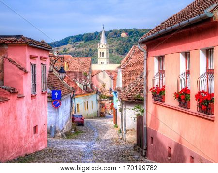 Traditional street and architecture inside the citadel of Sighisoara, in Transylvania - Romania