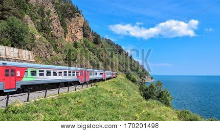 KIRKIREY IRKUTSK REGION RUSSIA - July 292016: Baikal Express. Tourist train travel. Organised tour of Circum-Baikal Railway. Route passes through picturesque shore of deep lake