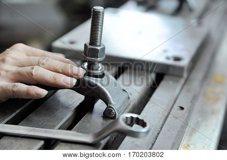 Closeup on a worker's hand during press form manual preparation