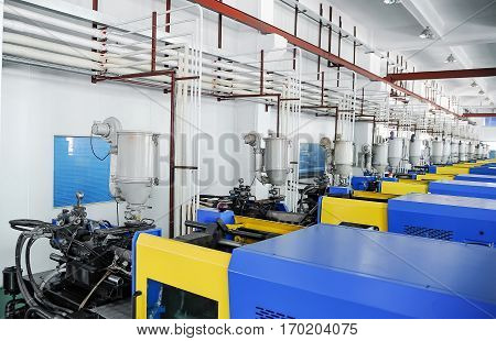 View on plastic injection CNC machines at empty workshop